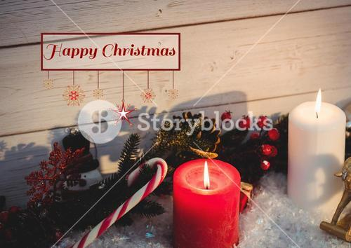 Happy christmas message on wooden background against christmas decoration