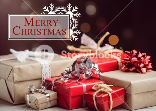 Merry christmas message against christmas gift boxes
