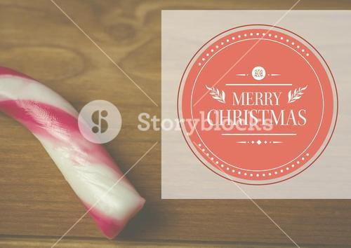 Composite image of merry christmas with candy cane