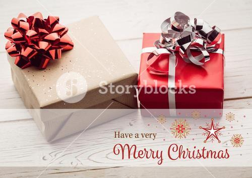 Digitally composite image of merry christmas against christmas gifts