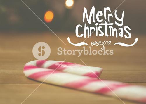 Digitally composite image of merry christmas with candy cane