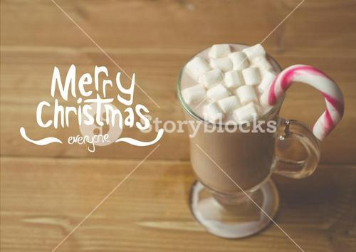 Digitally composite image of merry christmas against a cup of hot chocolate with marshmallows