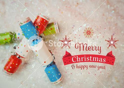 Digitally composite image of merry christmas and happy new year message against christmas crackers