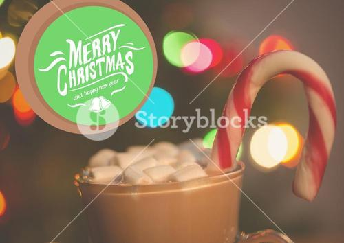 Digitally composite image of merry christmas and a cup of hot chocolate with marshmallows and candy