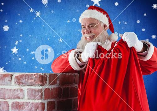 Santa claus placing his gift sack into the chimney
