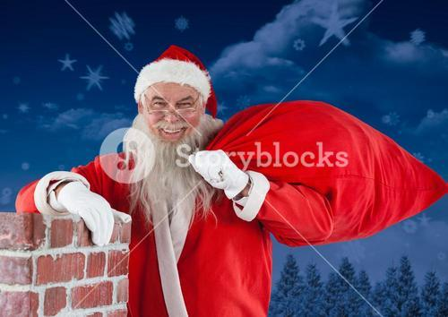 Santa claus standing besides chimney with his gift sack
