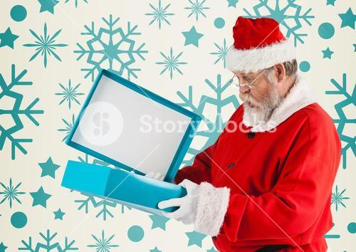 Surprised santa claus opening his christmas gift