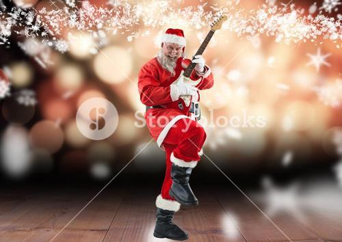 Santa claus playing electric guitar on wooden plank