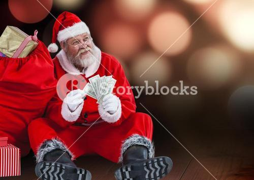 Santa claus with gift sack holding dollars while sitting on wooden plank