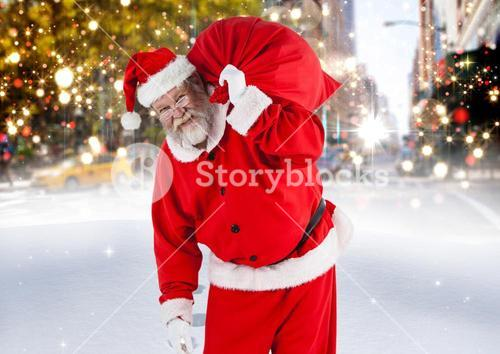 Santa claus with gift sack walking on the street