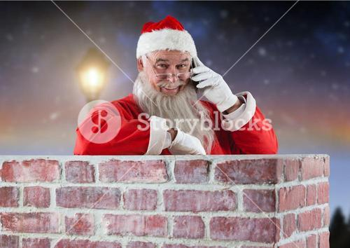 Santa claus inside a chimney talking on mobile phone