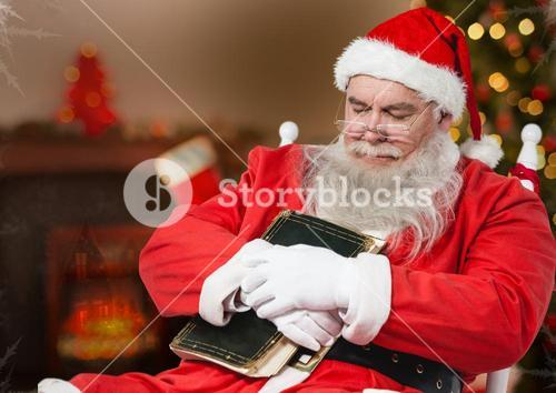 Santa claus with a diary sleeping on a chair