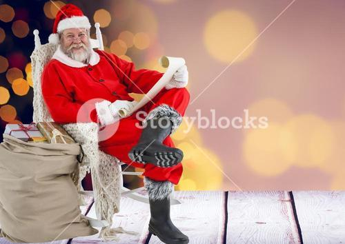 Santa claus holding wish list with sack of gifts
