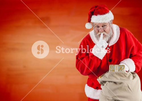 Santa claus holding gift sack with finger on lip