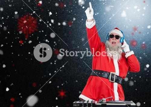 Dj santa claus mixing up some christmas songs