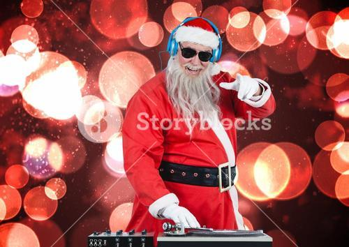 Dj santa mixing up some christmas songs