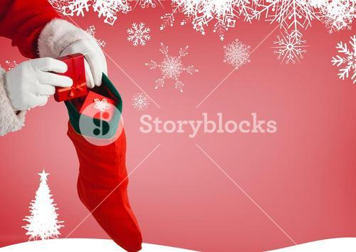 Santa claus putting gifts in christmas stockings
