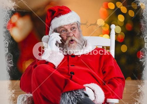 Santa talking on his phone while sitting on a chair