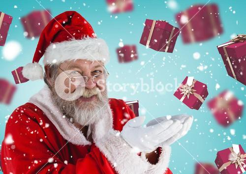 Santa pretending to hold digital generated christmas gifts