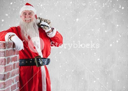 Happy santa with gift sack standing beside chimney