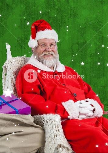 Smiling santa claus sitting with gift sack
