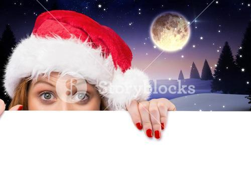 Woman in santa hat peeking over white card
