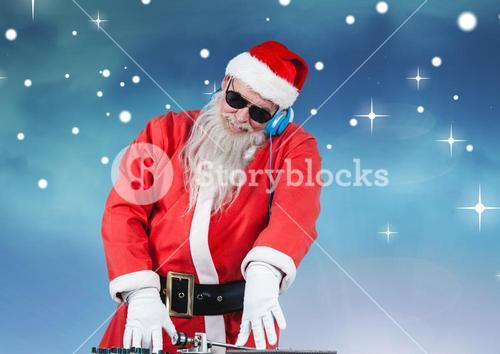 Santa in sunglasses playing dj