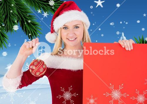 Beautiful woman in santa costume holding red placard and bauble