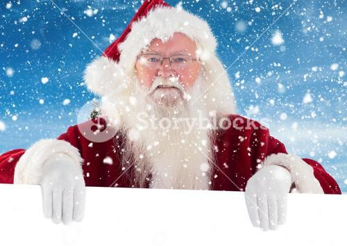 Santa clause holding white placard
