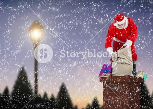 Santa claus opening gift sack on top of house chimney