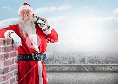 Happy santa claus leaning on a wall while holding gift sack