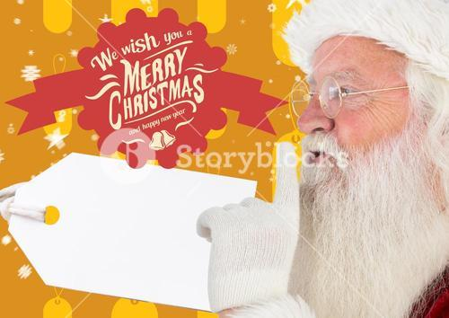 Santa claus with finger on lip against merry christmas greetings