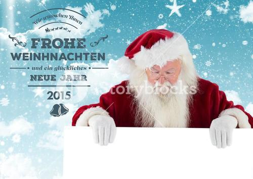 Merry christmas greetings with santa claus holding placard