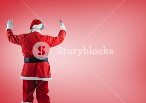 Santa claus standing against red background