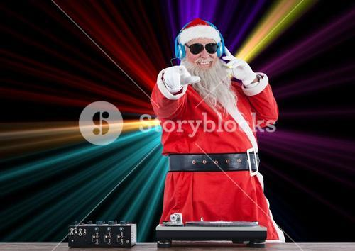 Dj santa claus mixing up some Christmas cheer