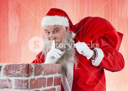 Santa claus with finger on lips carrying gift bag