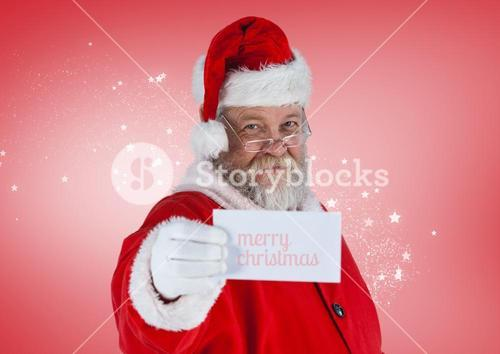 Santa claus showing a merry christmas card
