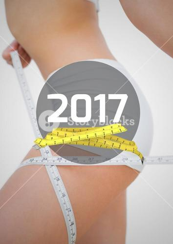 Woman measuring her thigh against 2017