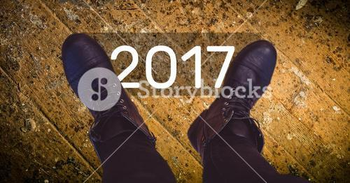 2017 new year wishes against black boots