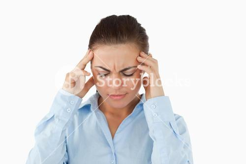 Businesswoman suffering from a headache