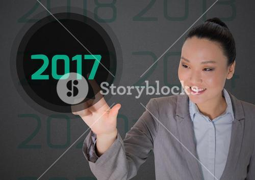 Business woman in digitally generated background touching 2017