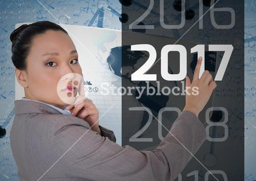 Thoughtful business woman touching 2017 message in 3D digitally generated background