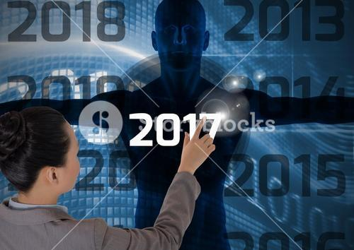 Woman touching 2017 on 3D digitally generated human body silhouette