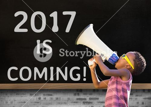 Boy with megaphone against 2017 new year sign