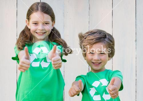 Two smiling children showing thumbs up