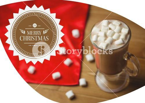 Merry christmas greetings with coffee and marshmallow in glass