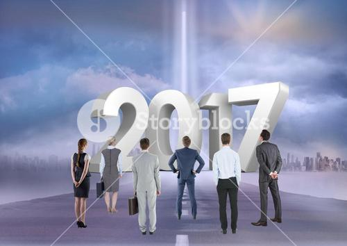 Composite image of 3D 2017 with business people on road to success