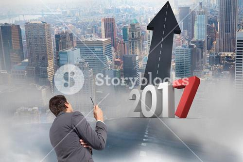 3D 2017 against a composite image of business man looking at road leading towards sky