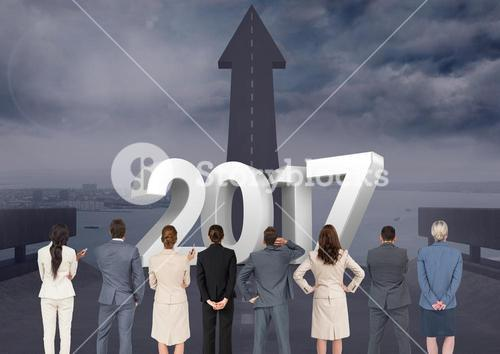 3D 2017 against composite image of business people looking at road leading towards sky