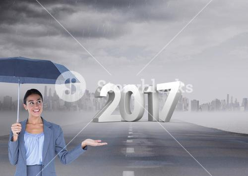 3D 2017 against composite image of woman holding an umbrella on road